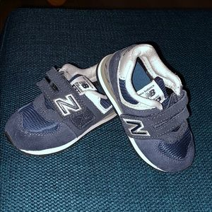 Baby/Toddler New Balance tennis shoes.